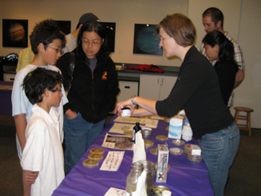 Dr. Bernhardt shows visitors how to test bacterial clearing.